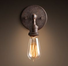Evoking early 20th-century industrial lighting, our reproductions of vintage fixtures retain the classic lines and exposed hardware of the originals. Designed to showcase the warmth of Edison-style filament bulbs.