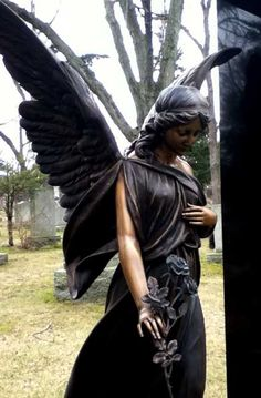 Unique angel dressed in black, with a beautiful rose in her hand!