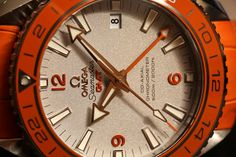 "Omega Seamaster Planet Ocean GMT Orange Ceramic Watch In Platinum Hands-On - Read Ariel's take on this watch and see the full, bright-orange, photo gallery on aBlogtoWatch.com ""The reason Omega has produced only eight pieces of this limited edition Seamaster Planet Ocean is because the orange bezels currently take a lot of work..."""