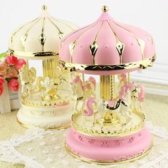 This is a bedside lamp disguised as a pretty merry-go-round! It can play music too.