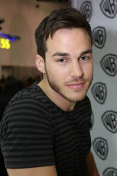 As Comic-Con 2015 visitors line up, Chris Wood (Jake) prepare to sign posters and help spread the word about the new drama series CONTAINMENT in the Warner Bros. booth on July 11. #WBSDCC
