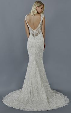 Kalinda wedding dress by Kelly Faetanini // Beaded embroidery stretch fit to flare with cap sleeve and plunging illusion back #weddingdress