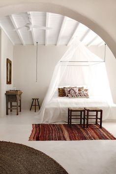A mosquito-net draped bed at the San Giorgio Hotel in Mykonos (see the rest of the hotel at Bohemian Paradise Found).