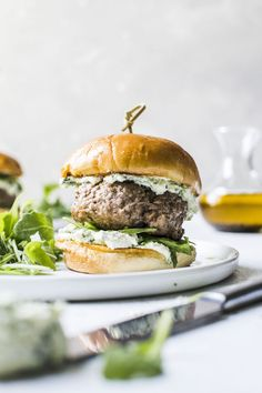 These lamb burgers can be made on the grill on in a skillet and are topped with a must-try pesto whipped feta, aka your new favorite burger topping! // The Almond Eater Lamb Burger Recipes, Lamb Recipes, Cooking Recipes, Healthy Recipes, Cooking Food, Delicious Recipes, Falafels, Bagels, Pesto