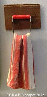 Find yourself a vintage wooden handled pastry blender and turn it into a towel holder. .......D.