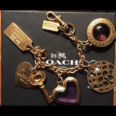 Amazing Authentic Coach Daphne Charm Bracelet rare This is an amazing authentic coach Daphne Charm Bracelet. It has super cute purple and gold charms. This bracelet is super hard to find and rare. It is in great condition and would be perfect to complete or start your Coach Charm Bracelet collection. Coach Jewelry Bracelets