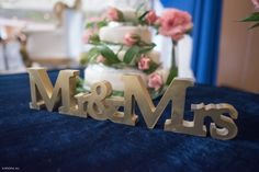 Mr & Mrs golden sign placed in front of wedding cake for that added decor and setting