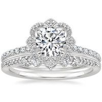 A regal halo of diamond accents surrounds a shimmering center gem in this dazzling ring for a distinctive and elegant look.