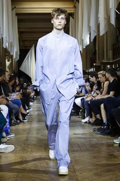 The crispness of shirting material felt refreshing in the early morning heat. White flags hung from their poles, drawing the eyes to the far end of the runway, giving the Galerie de Minéralo...