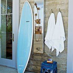 An outdoor shower is practical and beautiful.  Guests will feel taken care of with clean towels put out for their return from the beach.