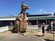 KANGAROO KAT. Gold Coast, Australia. Thomas Dambo. Part of a 3-sculpture piece made from recycled materials at a large market. It was designed to allow visitors to go inside its pouch, which is a huge hit amongst the kids at the market.