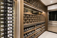 Fabulous lower floor designer wine cellar reflecting luxury by Averna Homes