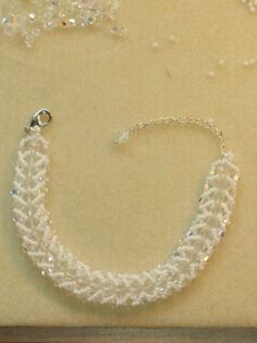This is my Flat Spiral stitch bracelet. Made with 4mm Swarovski crystals AB bicones, 6mm Swarovski crystals rounds, and white Toho 11/0 seed beads.