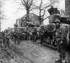 Accompanied by M4A3E2 'Jumbo' tanks, soldiers of the 9th US Infantry Division, concentrate near Rath, on February 27, 1945.