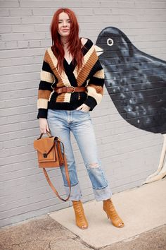 striped top with faded jeans and peep toe boots