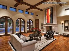 dramatic custom home combines classic old world elegance with stunning modern accents!