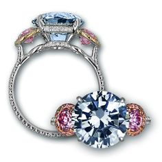 Platinum and rose gold ring set with a 4.02 carat round brilliant Fancy Dark Grey diamond flanked by 2 Fancy Purplish Pink round brilliant diamonds totaling 0.74 carats