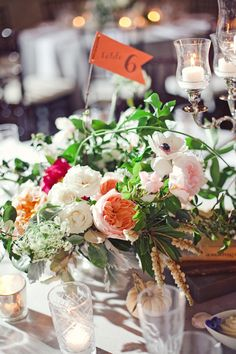 garden centerpieces with flag table numbers   The Nichols #wedding
