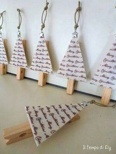 I would use wood triangles and put sheet music on it via acrylic transfer. Then line them up on a long piece of twine to display Cmas cards. [mFm]
