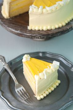 a light, tender coconut milk chiffon cake (made with butter and coconut oil) filled with an amazing, rich mango curd; covered in a reduced mango puree whipped cream cheese frosting