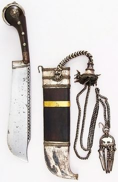 Indian (Kodagu) pichangatti knife, 18th to 19th century, steel, horn, silver, brass, wood (rosewood), coral,  H. with sheath 12 5/8 in. (32.1 cm); H. without sheath 11 5/8 in. (29.5 cm); W. 1 7/8 in. (4.8 cm); Wt. 11.8 oz. (334.5 g); Wt. of sheath 10.4 oz. (294.8 g), Met Museum, Bequest of George C. Stone, 1935.
