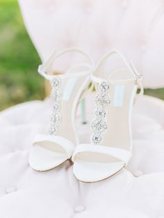 White strappy wedding shoes: http://www.stylemepretty.com/texas-weddings/fredericksburg/2016/04/05/rose-quartz-serenity-filled-texas-winery-bridal-inspiration/   Photography: Tenth & Grace - http://www.tenthandgrace.com/