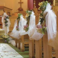 White Tulle by the Bolt decorating a church wedding aisle.