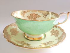 Gracious Green and Gold Paragon Teacup and Saucer, Tea Cup, Tea Set, English Tea Cups, Double Warranty, Bone China Teacups, Tea Sets by AprilsLuxuries on Etsy https://www.etsy.com/listing/207511549/gracious-green-and-gold-paragon-teacup