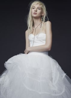 LOOK 10. Light ivory strapless silk crepe ball gown with architectural drape, ruched overlay at skirt, accented by hand appliqué chantilly lace, mini scattered crystals and silk organza flowers