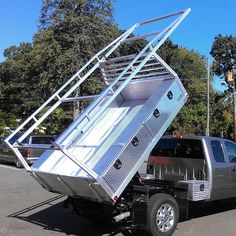 This Custom Truck Bed comes with a rear gate, stow-away panels, headache rack, & lights. The truck bed fits Dodge, Ford, GMC, Chevrolet, & more.