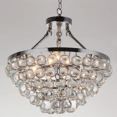 Add an eye-catching accent to any room in your home with this opulent Elsa chandelier, featuring a chrome finish. Decked out with spherical glass crystals, this gorgeous fixture features five bulbs to provide plentiful light.