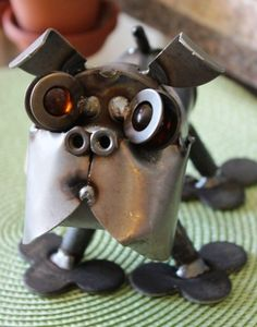 Love these funny little metal dog sculptures!