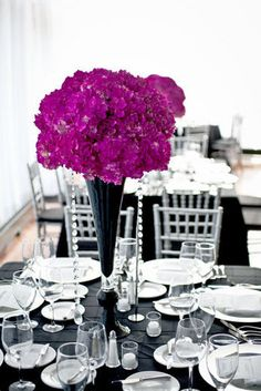 Stunning....grey table cloth, grey vase with blush flowers and other blush accents