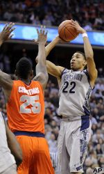 Georgetown emphatically ended its Big East rivalry against Syracuse, wrapping up the regular-season title by holding the Orange to the lowest scoring output of their time in the conference.
