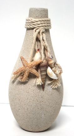 A fun and unique bud vase, textured and colored like sand, makes a perfect accent piece for any beach house, cottage, or surf themed home. Seashell Art, Seashell Crafts, Beach Crafts, Wine Bottle Crafts, Bottle Art, Wine Bottles, Deco Marine, Do It Yourself Wedding, Altered Bottles