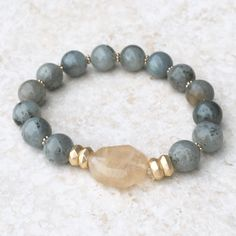 The olive marble beads and the natural statement stone on this bracelet make it a beautiful piece to wear alone or stack along with your favorite everyday brace