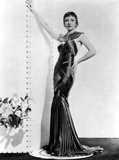 Claudette Colbert's wardrobe always screams art deco designs.  Love all her costumes.
