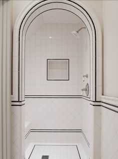 12 Ideas For Designing An Art Deco Bathroom Discover stylish art deco bathroom design ideas. Art Deco influenced the black and white design. White Tile Shower, White Bathroom, Modern Bathroom, Master Bathroom, Bathroom Mirrors, Vintage Bathrooms, Glass Bathroom, Small Bathrooms, 1930s Bathroom