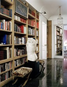Custom designed oak book cases by Parisian designer Jacques Grange.