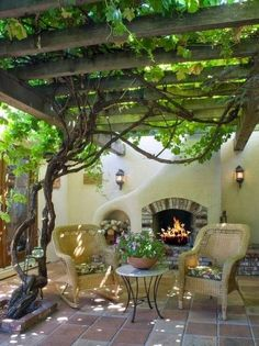small patio ideas fireplace outdoor furniture wooden pergola grapevines