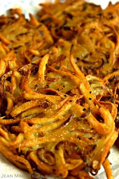 Shoestring Potato and Onion Pancakes (Latkes)  These latkes are very tasty and unlike the latkes traditionally served with applesauce, sour cream or even compound butters these crunchy and spikey babies are delicious all by themselves.