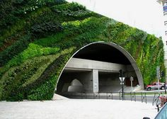Vertical garden by Patrick Blanc. I wish more roadways were planted like this to soften the concrete.
