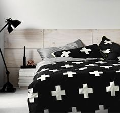 Crosses Black AURA  Whether you cross your T's, cross your heart, or cross your fingers, whatever you do, don't cross this quilt cover off your must-have list. From its jet black sateen to its daring lime trim, and every creme cross in between, this is one bedroom statement sure to impress.  Features: Cotton sateen 360 thread count Lime tube piping Reversible - #quiltcovers