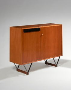 Ico Parisi; Walnut, Enameled Metal and Brass Cabinet, c1950.