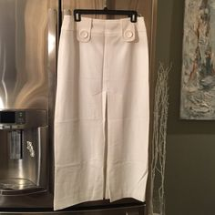 NWOT Body by Victoria white long skirt NWOT In excellent condition. Long white skirt with center slit. 36 inches long and slit starts from waist at 13 inches down. Very stylish and modern. Lined Victoria's Secret Skirts Maxi