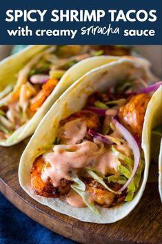 Spicy Shrimp Tacos with Creamy Sriracha Sauce & Cilantro Lime Slaw - - Spicy Shrimp Tacos with Creamy Sriracha Sauce & Cilantro Lime Slaw Seafood Recipes Würzige Shrimps-Tacos mit cremiger Sriracha-Sauce und Koriander-Limetten-Krautsalat Shrimp Taco Recipes, Fish Recipes, Mexican Food Recipes, Shrimp Taco Sauce, Seafood Pasta, Chicken Recipes, Sauce For Tacos, Spicy Food Recipes, Shrimp Taco Seasoning