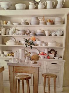hutch with white dishes, serving pieces