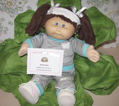 Cute Cabbage Patch Kid  Mine had this outfit except green trim.