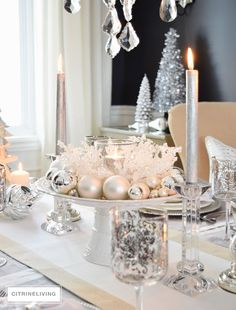 Crisp whites and cool metallics are layered together for a fresh winter wonderland inspired holiday tablescape for Christmas or New Year's.