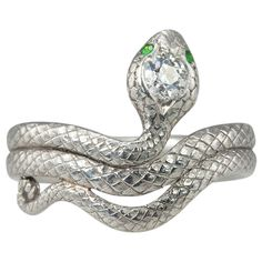 Deco Diamond and Demantoid Snake Ring.  Serpentine finery! The detail on this platinum snake is wonderful! He has a .35 carat Old European cut diamond (I-VS2) in his head and 2 small demantoid garnets as eyes. As you can see from the photos his engraved scales are in great condition.  1920s.